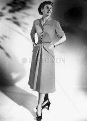 Woman in a striped dress  1940s.