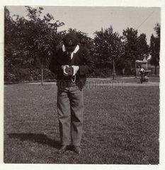 Schoolboy taking a photograph  c 1905.