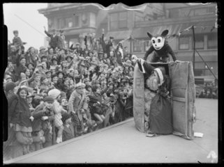Father Christmas arrives at Selfridges by parcel post  with Mickey Mouse  1935.