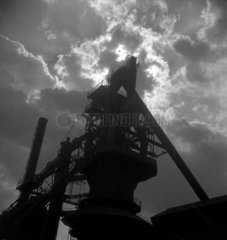 Blast furnace silhouetted against clouds Scunthorpe 1947.