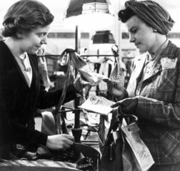 Shopping with clothing coupons  World War Two  c 1942.