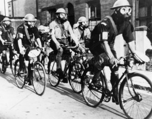 Rover Scouts wearing gas masks cycling in Portsmouth  14 July 1937.