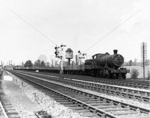 Empty freight train No 2818 passing Honeybourne  June 1961.
