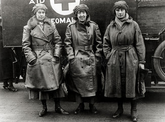 Three nurses standing outside their ambulance  England. c 1914-1918