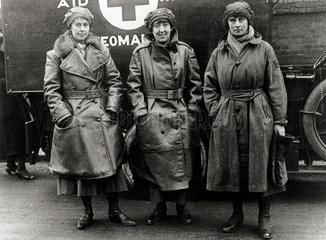 Three nurses standing outside their ambulance  England. c 1914-1918