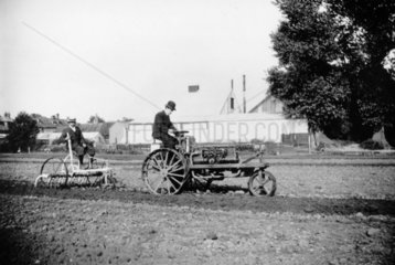 Ivel tractor pulling cultivator  c 1900s.