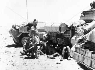 British sodiers resting by their tanks in Libya  11 July 1946.