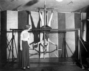Woman on a gyro wheel  Fortnum and Mason  London  February 1932.