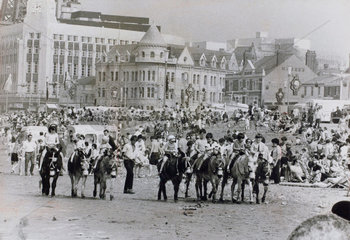 Holidaymakers enjoying themselves on Blackpool beach  April 1972.