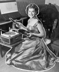 Putting on a record  10 September 1957. 'Th