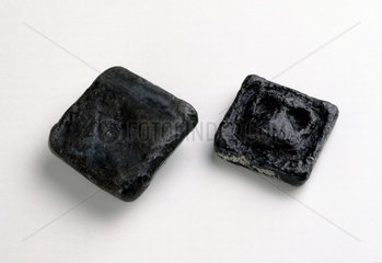Two ancient Greek lead weights  c 300 BC.