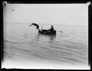 'Woman Diving From Boat Into Sea'  c 1897.
