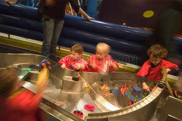 Children playing in The Water Zone  Science Museum  London  2007.
