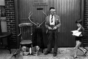 Man with antique bric-a-brac  Wormwood Scrubs  London  1967.