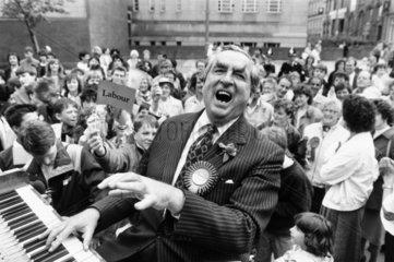 Dennis Healey playing the piano at Huddersfield Town Hall  May 1987.