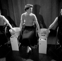 Women volunteers test effects of soap suds on hands  1954.