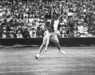 Tennis player Helen Jacobs in action at