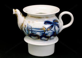 Glazed white porcelain teapot and part of tea warmer  c 1751-1860.