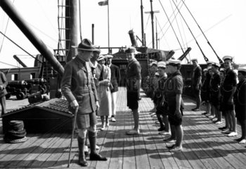 Lord Baden-Powell (1857-1941) inspecting a