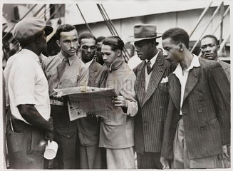 Waiting to disembark from the 'Empire Windrush'  21 June 1948.
