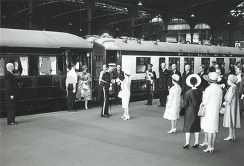 The Queen shaking hands with a naval officer in front of Royal Train  c 1960.