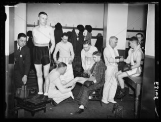 Amateur boxers prepare in the changing room  Royal Albert Hall  London  1935.
