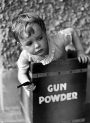 Small boy with toy gun  c 1930s.