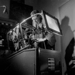 An engineer tests early colour televison camera at Mullard Ltd  1954.