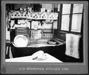 An untidy and dirty kitchen  1947-1955.