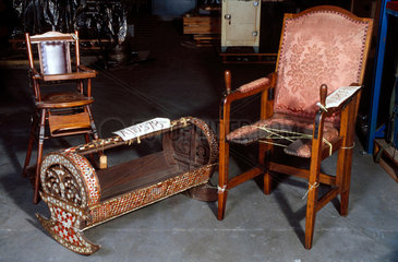 A collapsible parturition chair  a child's high chair and a cradle  1701-1830.