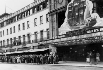 Queueing outside the Empire cinema to see 'Treasure Island'  London  1934.