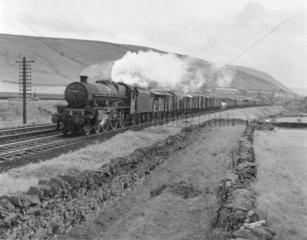 BR steam locomotive 'Howe' with a northbound goods train  1960s.