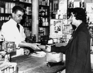 Woman buying sugar at the grocers  Septembe