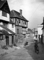 Man cycling through a quiet village street