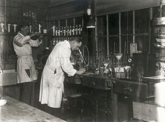 Two scientists at work in a laboratory  c 1930s.