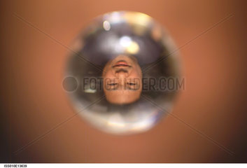 Commander Leroy Chiao's face in a water droplet in space  2005.