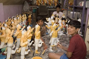 Calcutta  godheads made of loam as sacrificial offerings
