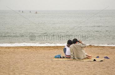 Qingdao  Paar am Strand