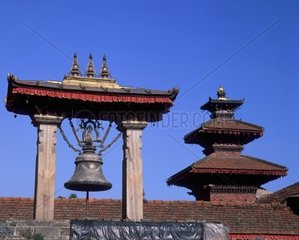 Nepal  Patan Durbar Square bell and temple roof