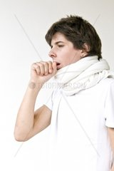 Teenage boy coughing