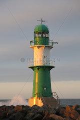 Warnemuende  Leuchtturm auf der Westmole im Abendlicht