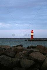 Warnemuende  Leuchtturm auf der Ostmole im Abendlicht