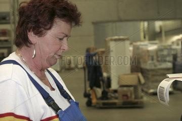 elder employee in the storage of Rhenus Logistic