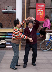 Shanghai  Dancing on the street.