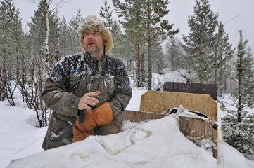 Europe  Sweden  Skelleftea  svansele wilderness camp  guide at work