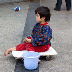 Sanya  begging child