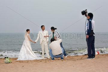 Qingdao  Hochzeitspaar  Foto shooting  Strand