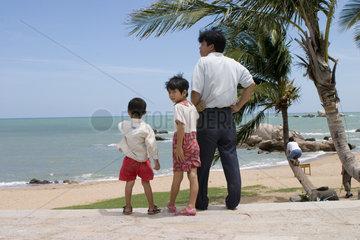 Hainan  Chinesen am Strand
