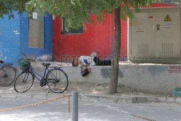 Beijing  Strassenszene  Alltag