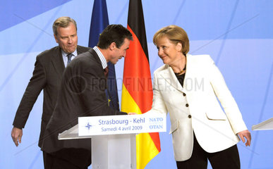 Hoop Scheffer + Rasmussen + Merkel